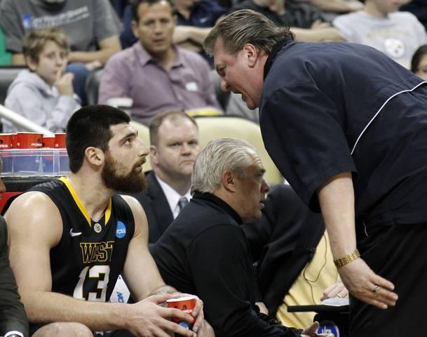 West Virginia coach Bob Huggins yells at Deniz Kilicli in the first half of their NCAA men's college basketball game against Gonzaga University