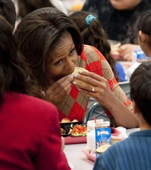 US First Lady Michelle Obama eats a turk