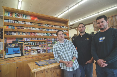 The Westminster Board of Health is considering a ban on tobacco sales in town. Brian Vincent, right, owner of VincentÕs Country Store, is upset with the way this will hurt his business. Also pictured are employees Vinny McInnis, left, and Jonathan Aho. SENTINEL & ENTERPRISE / Ashley Green